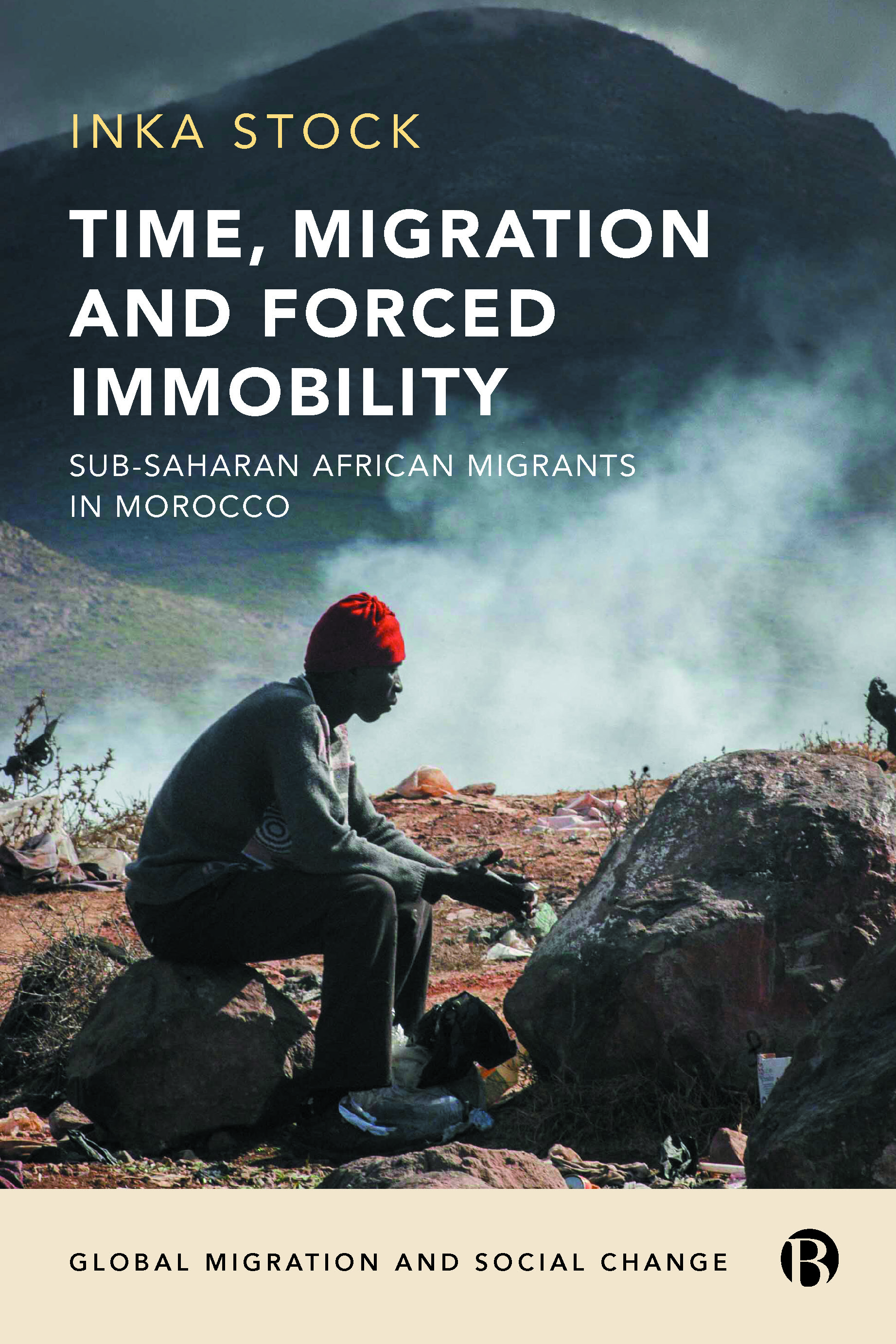 cover image of the book; man sitting on a rock next to a mountain range in Sub-Saharan Africa